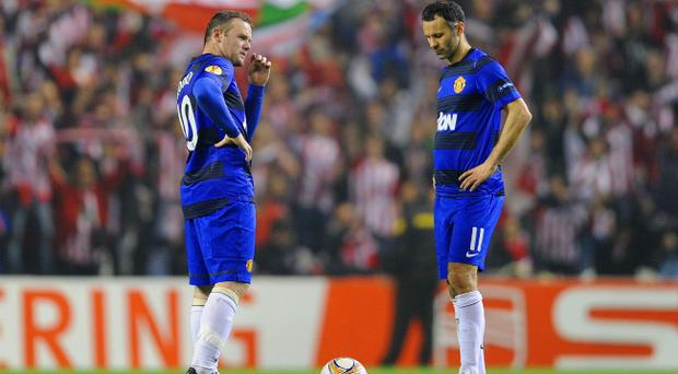 BILBAO, SPAIN - MARCH 15: Wayne Rooney (L) and Ryan Giggs of Manchester United look dejected after the 2nd Bilbao goal during the UEFA Europa League Round of 16 second leg match between Manchester United and Athletic Bilbao at San Mames Stadium on March 15, 2012 in Bilbao, Spain. (Photo by Michael Regan/Getty Images)