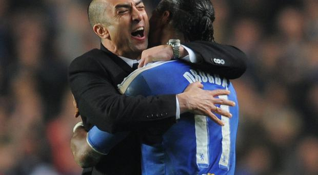 LONDON, ENGLAND - MARCH 14: Roberto Di Matteo caretaker manager of Chelsea celebrates victory with Didier Drogba after the UEFA Champions League Round of 16 second leg match between Chelsea FC and SSC Napoli at Stamford Bridge on March 14, 2012 in London, England. (Photo by Michael Regan/Getty Images)
