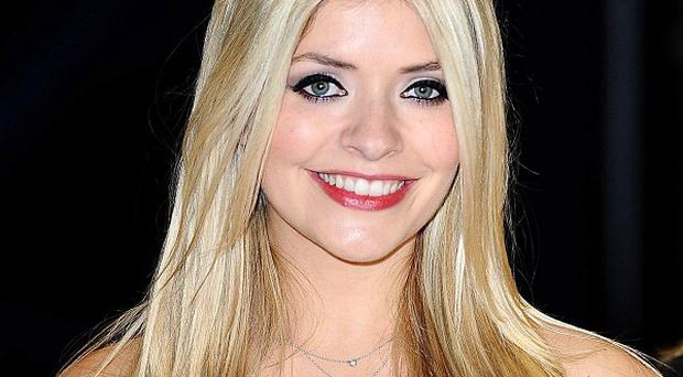 Holly Willoughby hopes to sing the theme tune to the revamped Surprise Surprise