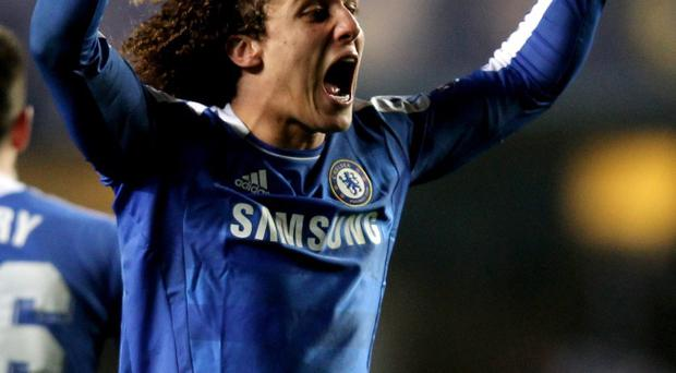 LONDON, ENGLAND - MARCH 14: David Luiz of Chelsea celebrates his team's victory after the final whistle during the UEFA Champions League round of 16 second leg match between Chelsea FC and SSC Napoli Stamford Bridge on March 14, 2012 in London, England. (Photo by Clive Rose/Getty Images)