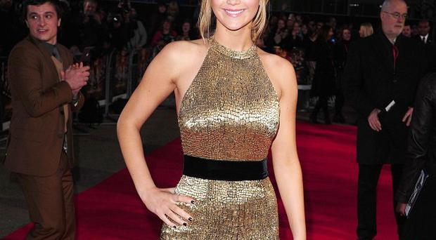 Jennifer Lawrence arrives at the premiere of The Hunger Games
