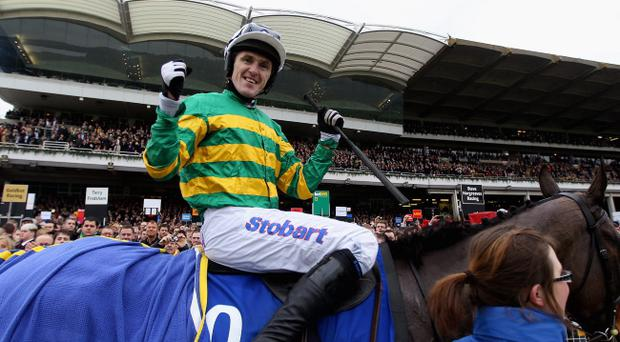 CHELTENHAM, ENGLAND - MARCH 16: Tony McCoy celebrates ridding Synchronised to victory in the Betfred Cheltenham Gold Cup Steeple Chase at Cheltenham Racecourse on March 16, 2012 in Cheltenham, England. (Photo by Warren Little/Getty Images)