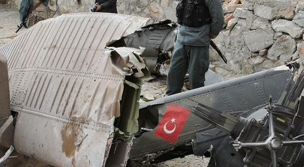 Twelve Turkish troops were killed when their helicopter crashed on the outskirts of Kabul, Afghanistan (AP)