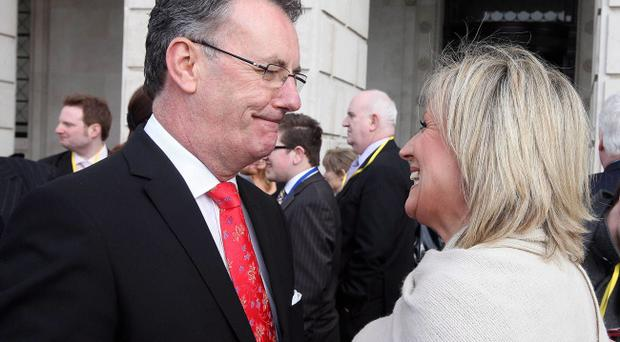 Mike Nesbitt launches his leadership bid at the front of Parliament Buildings at Stormont with other UUP MLAs and colleagues while giving a hug to his wife Lynda Bryans