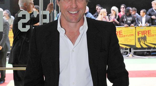 Hugh Grant is desperate to find out who is dirtying his doorstep