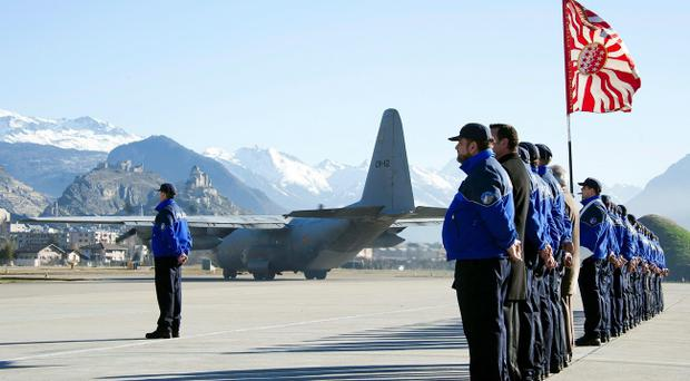 SIERRE, SWITZERLAND - MARCH 16: One of the two Belgian Hercules C-130 military cargo aircrafts takes off heading for Belgium with the 28 victims of Sierre's coach crash at Sion airport on March 16, 2012 in Switzerland. The accident occurred when a school bus carrying 11 -12 year old children back to Belgium from a skiing holiday, crashed into a tunnel wall, killing 28 of the 52 passengers. Belgium is holding a day of national mourning today to remember the victims of the crash. (Photo by Olivier Maire-Pool/Getty Images)