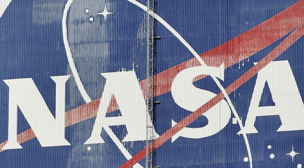 Nasa has held back the launch of a new X-ray telescope (AP)
