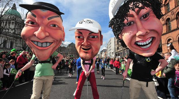 The golfing success of Darren Clarke, Graeme McDowell and Rory McIlroy is celebrated in the St Patrick's Day parade through Belfast city centre 2012