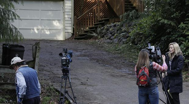 News crews gather at the home of US Army Staff Sgt. Robert Bales in Lake Tapps, Washington (AP)
