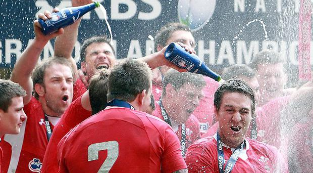 Wales' celebrate their third Grand Slam in eight years after during the RBS 6 Nations match at the Millennium Stadium, Cardiff