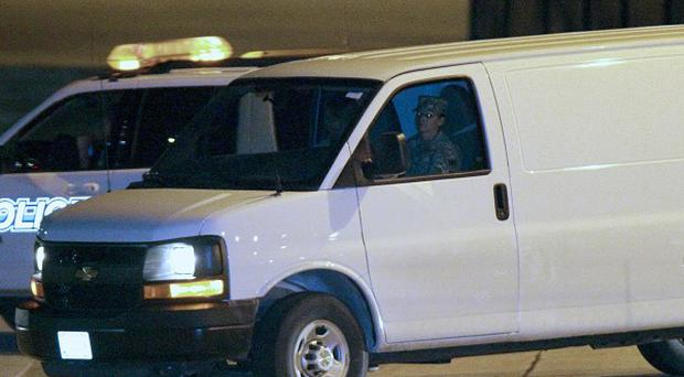 A white van, believed to be transporting Afghan shootings suspect Staff Sgt Robert Bales, leaves Kansas City International Airport (AP)