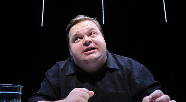Mike Daisey is shown in a scene from The Agony and The Ecstasy of Steve Jobs, in New York (AP)