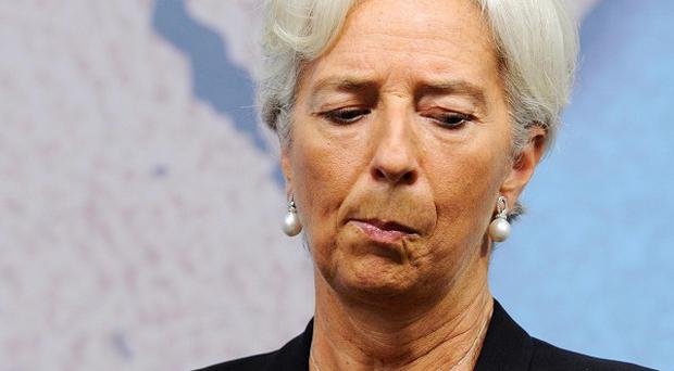 IMF chief Christine Lagarde has warned against complacency over global finance despite an upturn in fortunes