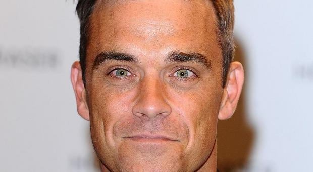Robbie Williams says that he's in good shape