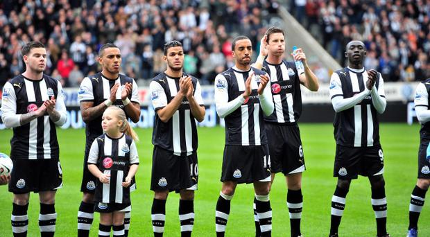 Newcastle United players join in with the minute's applause for Bolton Wanderers' Fabrice Muamba during the Barclays Premier League match at the Sports Direct Arena, Newcastle