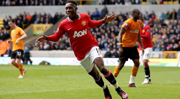WOLVERHAMPTON, ENGLAND - MARCH 18: Danny Welbeck of Manchester United celebrates after scoring their third goal during the Barclays Premier League Match between Wolverhampton Wanderers and Manchester United at Molineux on March 18, 2012 in Wolverhampton, England. (Photo by Scott Heavey/Getty Images)