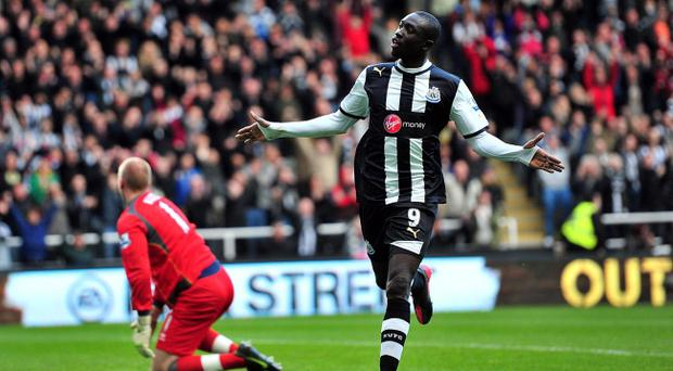 Newcastle United's Papiss Cisse celebrates scoring his first goal of the game during the Barclays Premier League match at the Sports Direct Arena, Newcastle