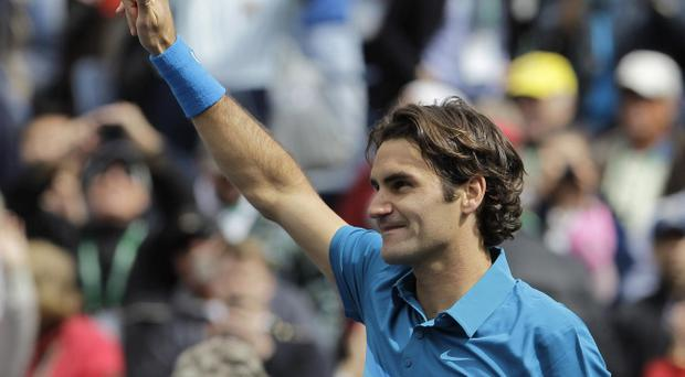 Roger Federer, of Switzerland, reacts after defeating John Isner, of the United States, 7-6 (7), 6-3 in the men's final at the BNP Paribas Open tennis tournament, Sunday, March 18, 2012, in Indian Wells, California