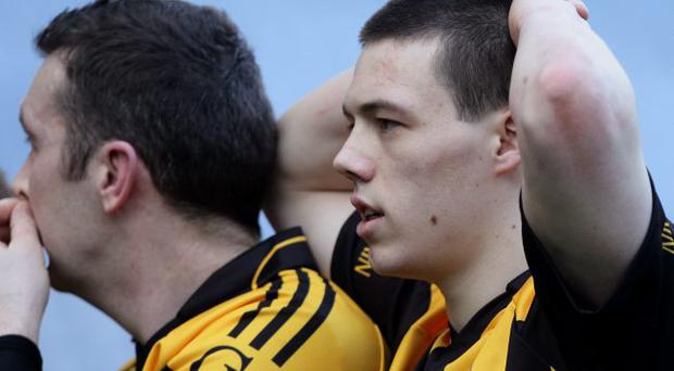 All square: Crossmaglen Rangers' James Morgan draws little comfort after the stalemate that will see his side resume battle with Garrycastle in the All-Ireland club football final