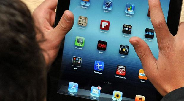 A customer tests out the the newest iPad at the Apple store in Covent Garden