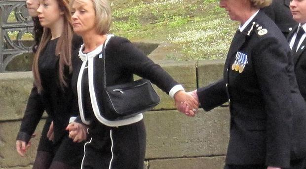 Northumbria Police chief constable Sue Sim holds hands with Kath Rathband, the widow of Pc David Rathband, at his memorial service