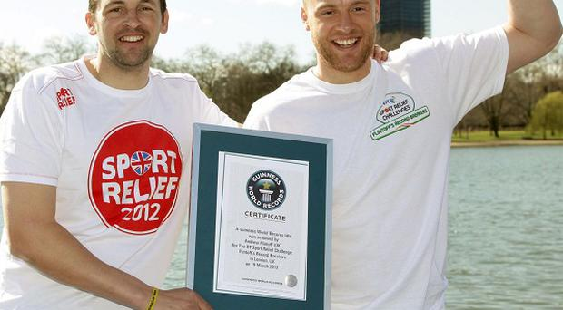 Freddie Flintoff, right, after his record breaking pedalo challenge with Steve Harmison