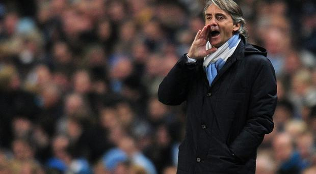 Manchester City manager Roberto Mancini is convinced his team will close the gap on United at the top of the table