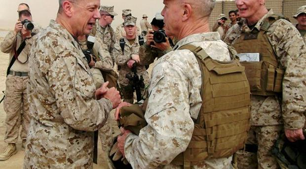 Marine General John Allen (left) gave no hint of an accelerated timetable for withdrawing US combat troops from Afghanistan (AP)