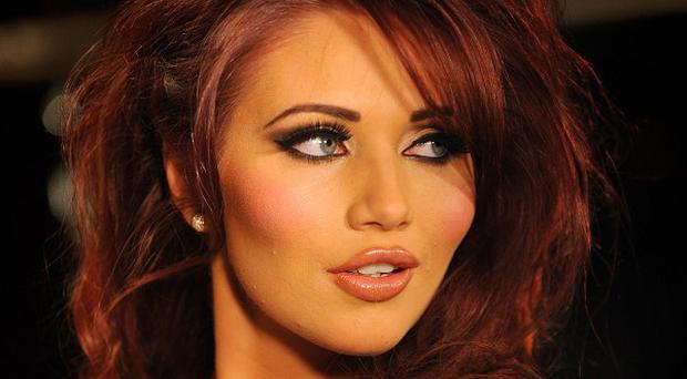 Amy Childs models designs from her SS12 fashion range, at the launch event at Gilgamesh, Camden