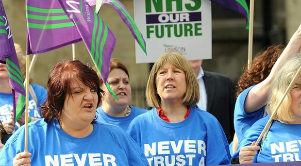 Health workers demonstrate outside the Houses of Parliament against the Health and Social Care Bill