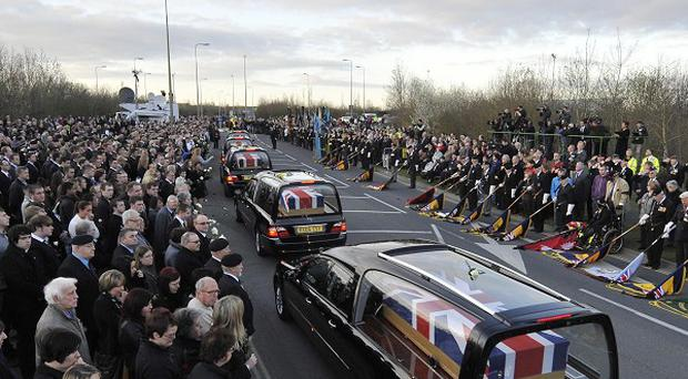 Hearses carrying the bodies of six soldiers killed in Afghanistan passes through Carterton in Oxfordshire after they were repatriated