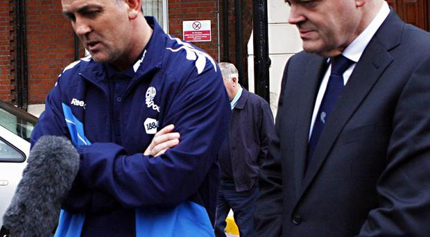 Owen Coyle (left) and Bolton chairman Phil Gartside