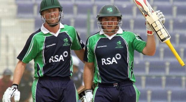 In form: Ireland's Andrew White congratulates Gary Wilson on reaching 50 against Oman on Tuesday