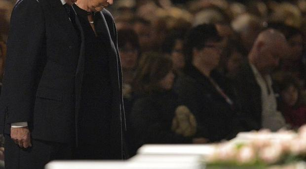 Belgium's King Albert II and Queen Paola participate in a memorial service to honour the victims of a bus crash in the Swiss Alps (AP Photol)