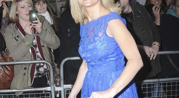 Amanda Holden insists she is fighting fit again following the difficult birth of her second daughter