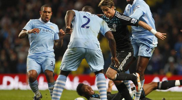 Chelsea's Fernando Torres (second right) takes on the Manchester City defence during the Barclays Premier League match at the Etihad Stadium, Manchester