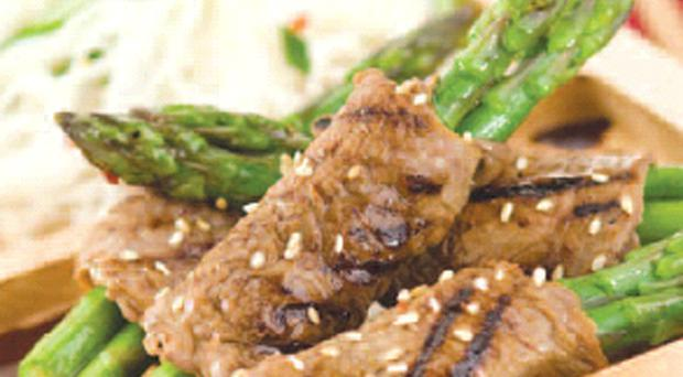 Asparagus wrapped in teriyaki beef