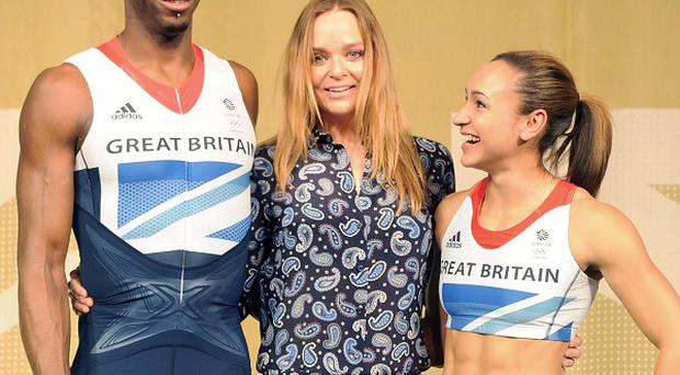 Phillips Idowu, left, and Jessica Ennis, right, pose with designer Stella McCartney as adidas unveil the British Team kit