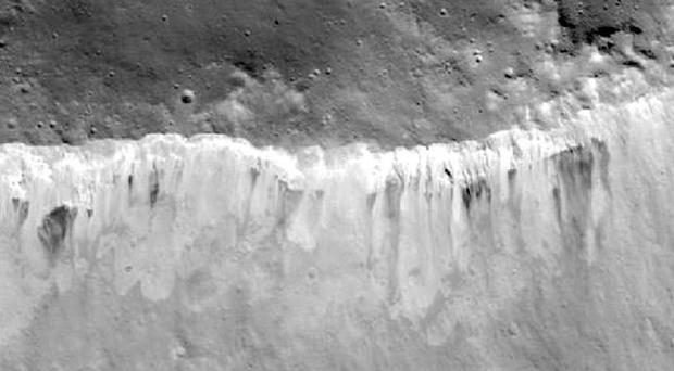 An image of bright and dark material at the rim of the Marcia crater on the Vesta asteroid (Nasa)