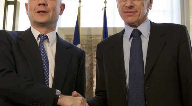 Italian foreign minister Giulio Terzi (right) shakes hands with Foreign Secretary William Hague at the end of a news conference in Rome (AP)