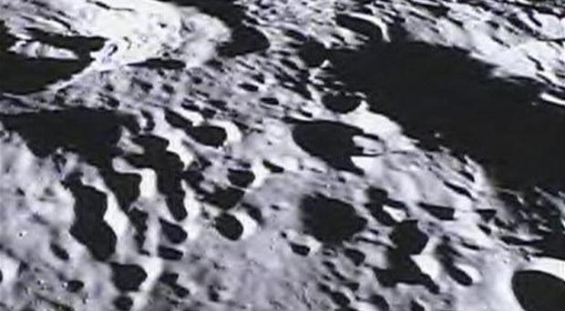 Images of the moon have been taken by one of Nasa's spacecrafts using a camera operated by school pupils (AP/Nasa)
