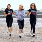 Kate Richardson (left), Juanita Brien and her daughter Tiffany get in training for the Belfast Telegraph's Runher 10k Coastal Challenge to take place on Friday, May 25. The new point-to-point sea shore route starts at Seapark, Holywood, and traces the coastal path to Crawsfordsburn Country Park