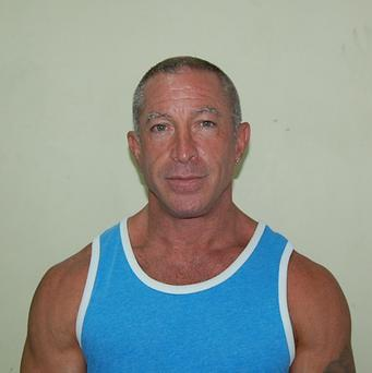 The police mugshot of Dennis Jay Mayer who has told of the conditions following his arrest on a cruise ship in the Caribbean (AP)