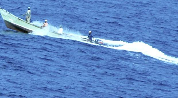 Pirates riding alongside an American cruise ship during a hijack attempt(AP)