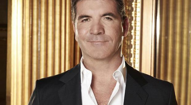 Simon Cowell admitted he poached Alesha Dixon from the BBC on purpose