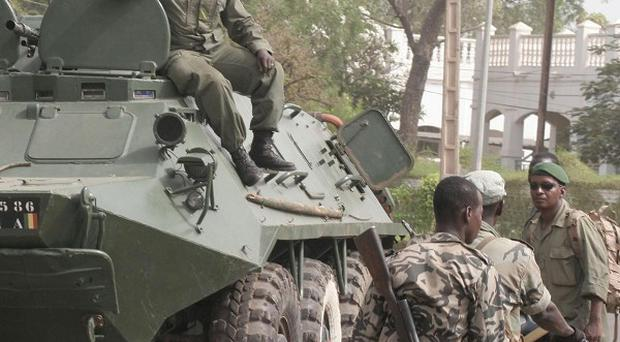 Soldiers secure the area around the presidential palace after a military coup in Bamako, Mali (AP)