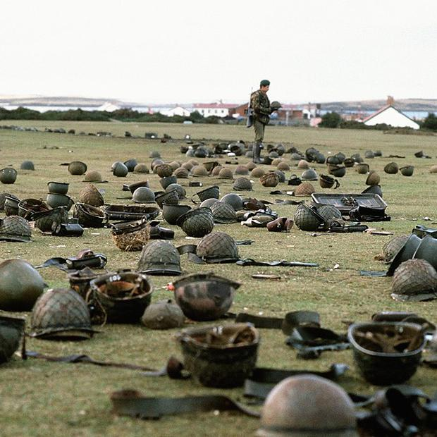 Steel helmets abandoned by Argentine armed forces who surrendered at Goose Green to British Falklands task force troops 30 years ago