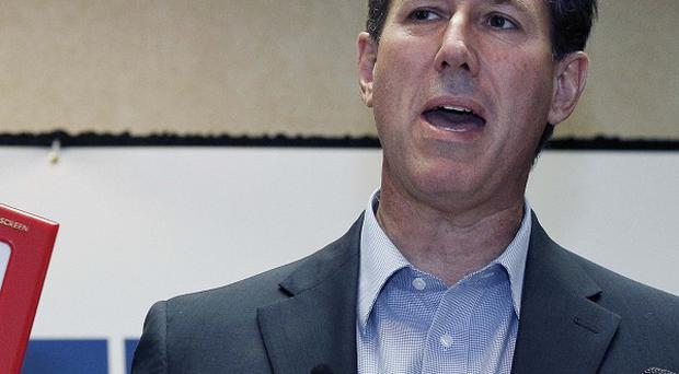 Rick Santorum has been tipped to beat Mitt Romney in Louisiana's vote for a Republican presidential candidate (AP)