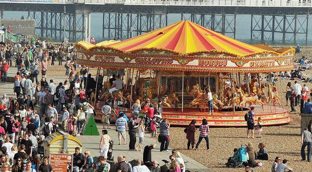 A crowded Brighton beach as the sun shines in Sussex