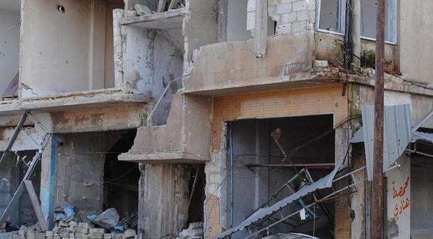 Shops and homes after they were destroyed by Syrian government shelling in Rastan town in Homs province (AP)